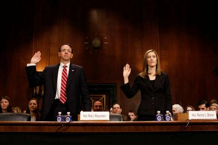 Rod Rosenstein, nominee to be Deputy Attorney General, and Rachel Brand, nominee for Associate Attorney General, are sworn before the Senate Judiciary Committee on Capitol Hill in  Washington March 7, 2017.  REUTERS/Aaron P. Bernstein
