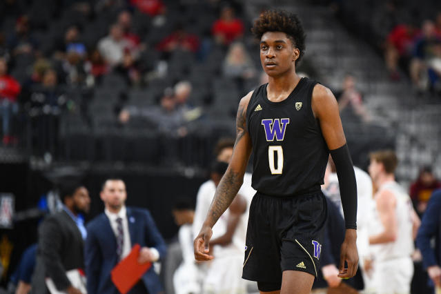 Huskies forward Jaden McDaniels looks on during a March game. (Photo by Brian Rothmuller/Icon Sportswire via Getty Images)