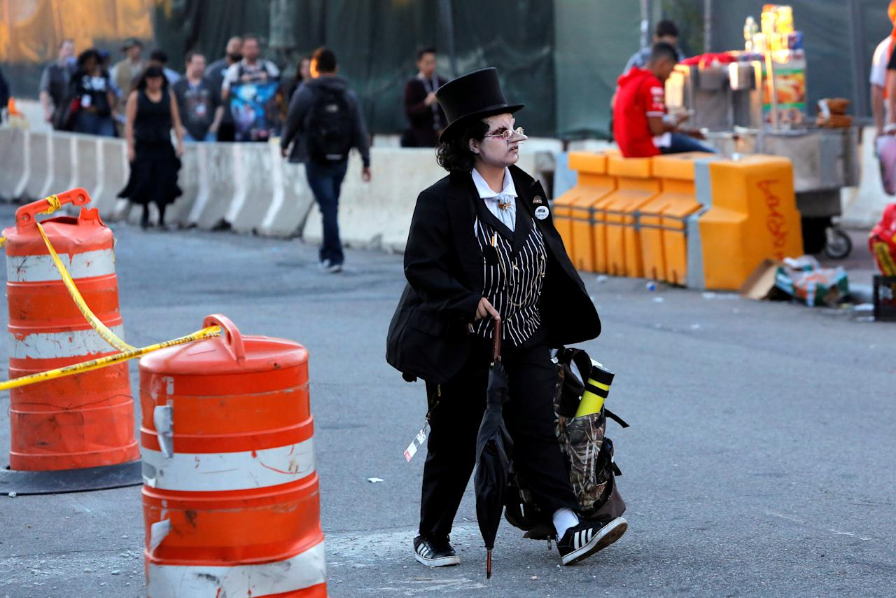 A person dressed as The Penguin leaves New York Comic Con in Manhattan, New York, U.S., October 7, 2016.  REUTERS/Andrew Kelly