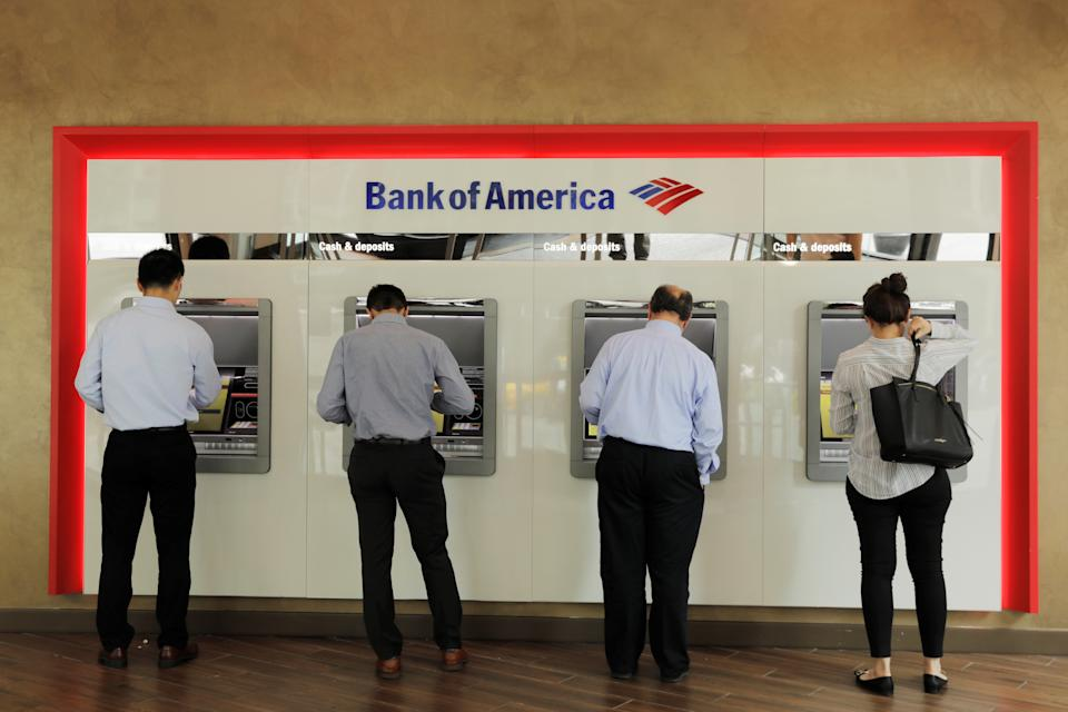 People withdraw money from Bank of America ATMs in New York U.S., July 16, 2018. REUTERS/Lucas Jackson