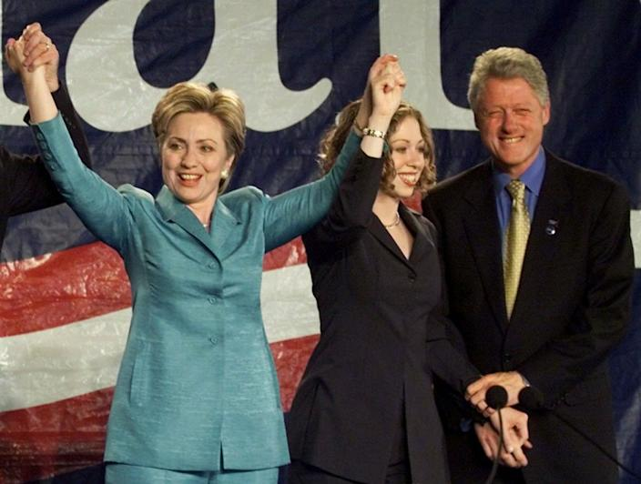 <p>Senator-elect Hillary Rodham Clinton, left, celebrates with former President Bill Clinton and their daughter, Chelsea, during her victory rally in New York on Nov. 7, 2000. (Photo: Ron Edmonds/AP)</p>