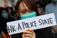 People attend a gathering to protest against what they say is the abuse of pro-democracy protesters by Hong Kong police, at Chater Garden in Central district, Hong Kong
