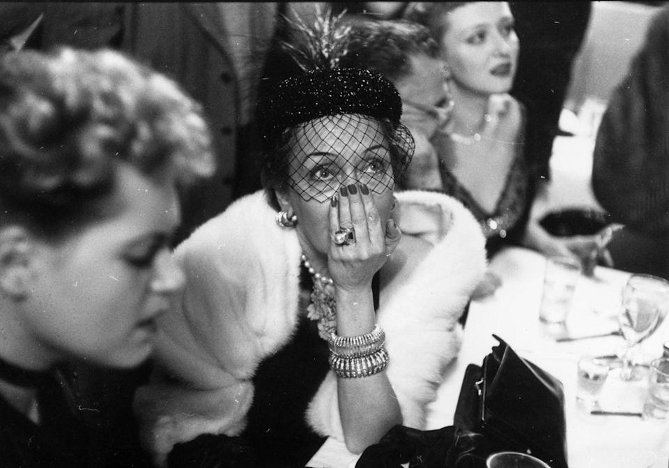 <p>The <em>Sunset Boulevard </em>star looked absolutely glamorous with a fishnet veil, all the statement jewels, and white shawl worn over a black dress. She won the Best Actress Oscar for her iconic role as Norma Desmond in the classic movie. </p>
