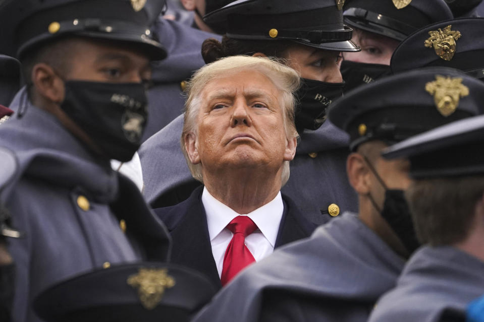Surrounded by Army cadets, President Donald Trump watches the first half of the 121st Army-Navy Football Game in Michie Stadium at the United States Military Academy on December 12. Source: AAP