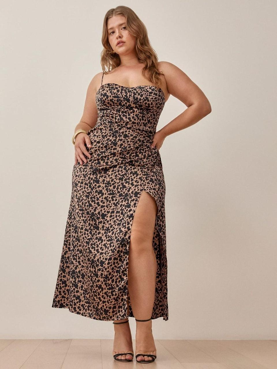 """Listen carefully…to the sound of necks snapping as you make your way to the buffet in this leopard stunner. $298, Reformation. <a href=""""https://www.thereformation.com/products/marguerite-dress?color=Blitz"""" rel=""""nofollow noopener"""" target=""""_blank"""" data-ylk=""""slk:Get it now!"""" class=""""link rapid-noclick-resp"""">Get it now!</a>"""