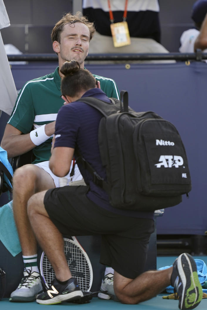 Daniil Medvedev, of Russia, receives medical attention in a break in a tennis match against Alexei Popyrin, of Australia, in the Miami Open tennis tournament, Sunday, March 28, 2021, in Miami Gardens, Fla. (AP Photo/Wilfredo Lee)