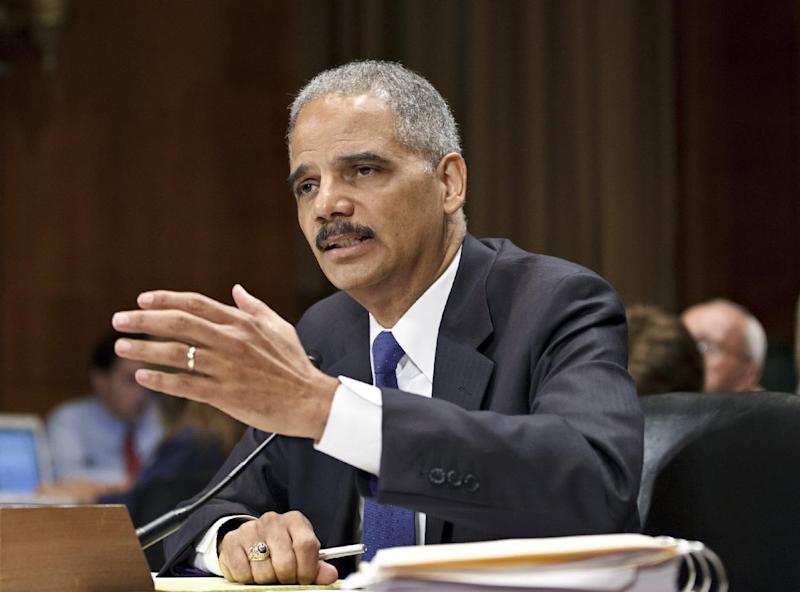 FILE - In this June 12, 2012 file photo, Attorney General Eric Holder testifies on Capitol Hill in Washington. In email exchanges with subordinates in February and March 2011, Attorney General Eric Holder and the department's second-highest official expressed growing concern that something might have gone wrong in a federal gun-smuggling probe called Operation Fast and Furious.  (AP Photo/J. Scott Applewhite)