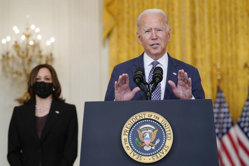 President Joe Biden speaks about the evacuation of American citizens, their families, SIV applicants and vulnerable Afghans in the East Room of the White House, Friday, Aug. 20, 2021, in Washington. Vice President Kamala Harris listens at left. (AP Photo/Manuel Balce Ceneta)