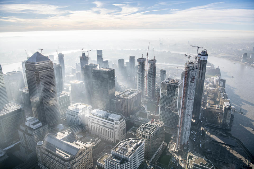 Dawn over Canary Wharf. (Photo: Jason Hawkes/Caters News)