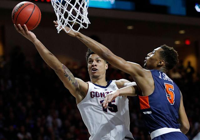 Gonzaga's Brandon Clarke shoots around Pepperdine's Jade' Smith during the first half of an NCAA semifinal college basketball game at the West Coast Conference tournament, Monday, March 11, 2019, in Las Vegas. (AP Photo/John Locher)