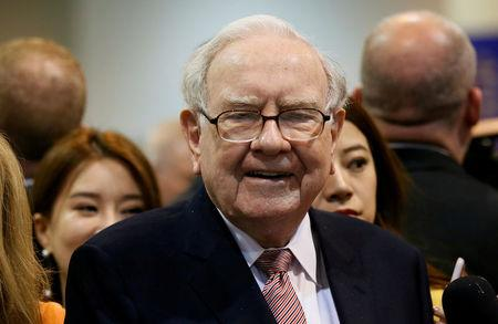 Berkshire boosts board size, adding Abel and Jain