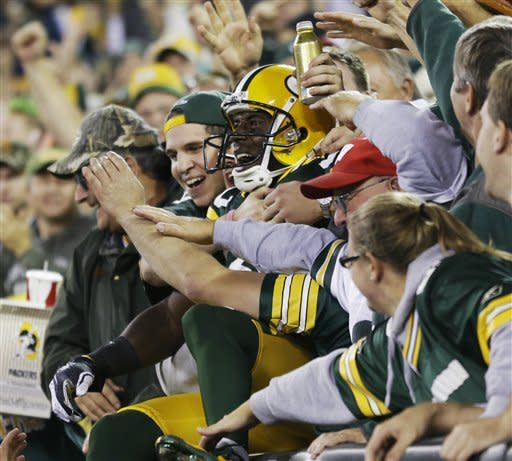 Green Bay Packers' Donald Driver celebrates with fans after catching a touchdown pass during the second half of an NFL football game against the Chicago Bears Thursday, Sept. 13, 2012, in Green Bay, Wis. (AP Photo/Morry Gash)