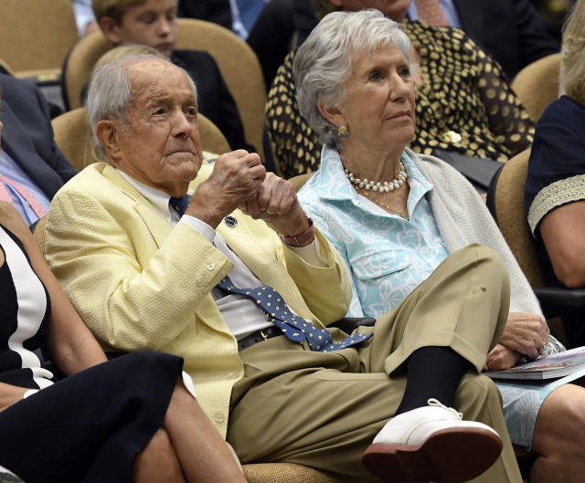 "FILE - In this Aug. 3, 2018, file photo, Dogwood Stables president W, Cothran ""Cot"" Campbell, left, sits with his wife, Anne, during induction ceremonies at the National Museum of Racing and Hall of Fame in Saratoga Springs, N.Y. Cot Campbell, who pioneered the concept of shared ownership of thoroughbred race horses and was a longtime advocate for the American racing industry, has died. He was 91. He died Saturday, Oct. 27, 2018, at his home in Aiken, South Carolina, the New York Racing Association said Sunday. (AP Photo/Hans Pennink, File)"