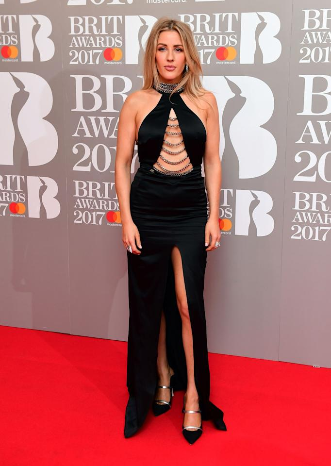 <p>The singer chose a revealing slitted gown by Philipp Plen. <i>[Photo: PA]</i> </p>