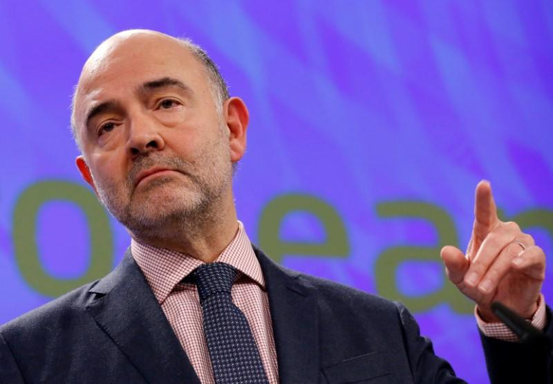 EU Commissioner Moscovici addresses a news conference in Brussels