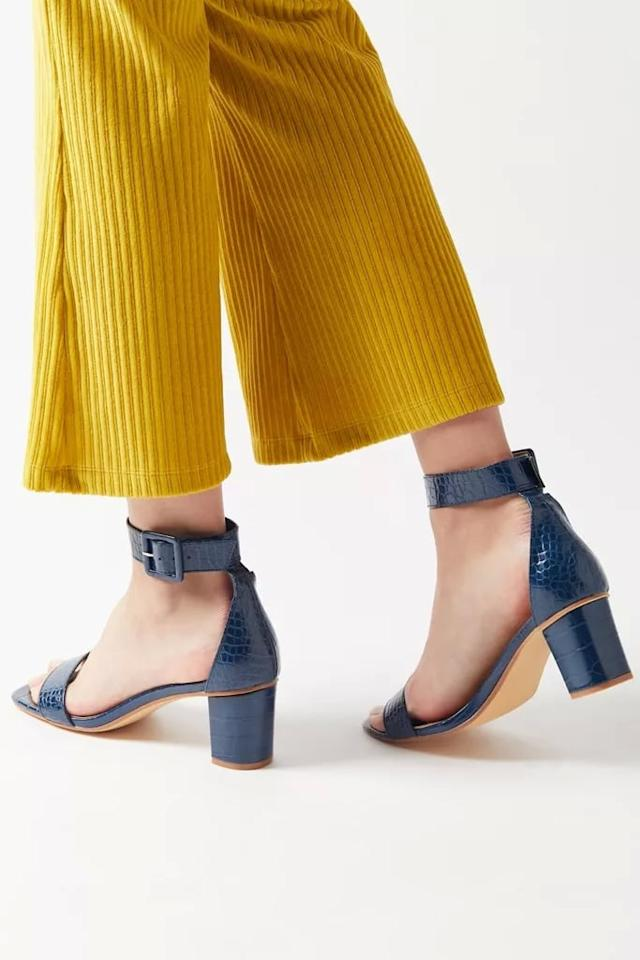 """<p>These comfortable <a href=""""https://www.popsugar.com/buy/UO-Luna-Crocodile-Heels-494982?p_name=UO%20Luna%20Crocodile%20Heels&retailer=urbanoutfitters.com&pid=494982&price=49&evar1=fab%3Aus&evar9=46084750&evar98=https%3A%2F%2Fwww.popsugar.com%2Fphoto-gallery%2F46084750%2Fimage%2F46684666%2FUO-Luna-Crocodile-Heels&list1=fall%20fashion%2Cshoes%2Cfall%2Cspring%2Csummer%2Cshoppping%2Cspring%20fashion%2Csummer%20fashion%2Caffordable%20shopping&prop13=api&pdata=1"""" rel=""""nofollow"""" data-shoppable-link=""""1"""" target=""""_blank"""" class=""""ga-track"""" data-ga-category=""""Related"""" data-ga-label=""""https://www.urbanoutfitters.com/shop/uo-luna-crocodile-heel?category=shoes-for-women&amp;color=041&amp;type=REGULAR&amp;quantity=1"""" data-ga-action=""""In-Line Links"""">UO Luna Crocodile Heels</a> ($49) also come in pink.</p>"""