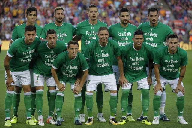 "(Above) Barcelona players huddle before the match with the word ""Barcelona"" substituted on their jerseys in place of their names. The gesture was meant to commemorate victims of the terror attacks in the city on Thursday. (Below) Real Betis players wore shirts to honor the victims before the match began as well. (Associated Press)"