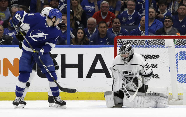 Tampa Bay Lightning center Anthony Cirelli (71) watches his deflection get past Los Angeles Kings goaltender Jack Campbell (36) for a goal during the first period of an NHL hockey game Monday, Feb. 25, 2019, in Tampa, Fla. (AP Photo/Chris O'Meara)