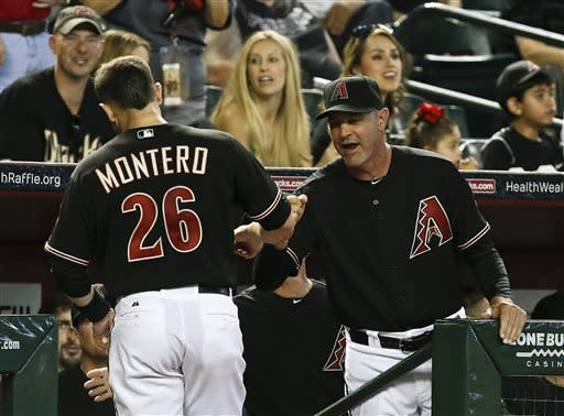 Arizona Diamondbacks manager Kirk Gibson, right, congratulates Miguel Montero (26) after he scores a run against the Colorado Rockies in the first inning during a baseball game, on Saturday, April 27, 2013, in Phoenix. AP Photo/Ross D. Franklin)