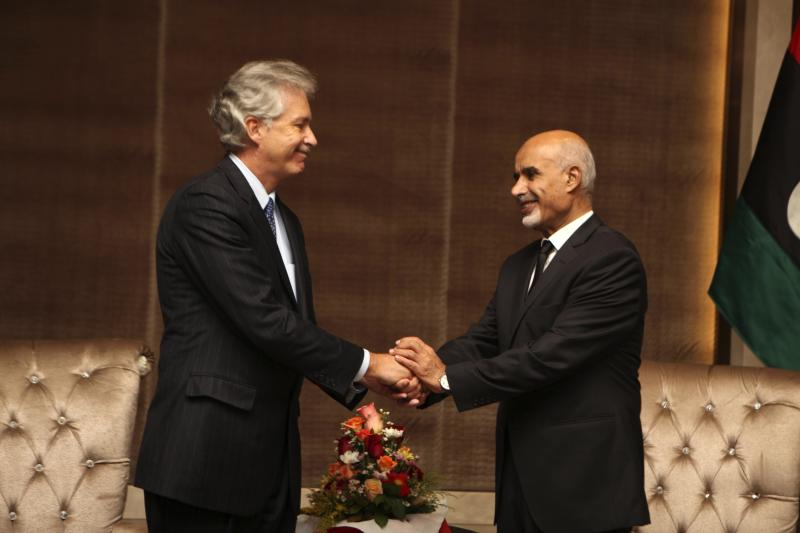 U.S. deputy Secretary of State William Burns, left, shakes hands with Libyan President Mohammed el-Megarif during a memorial service in Tripoli, Libya, Thursday, Sept. 20, 2012, for U.S. Ambassador to Libya, Chris Stevens, and three consulate staff killed in Benghazi on Sept. 11. The deputy U.S. secretary of state has met senior Libyan officials in Tripoli and attended a memorial service for the American ambassador and three consulate staffers killed in an attack last week. William Burns is the most senior US official to visit Libya in the aftermath of the Sept. 11 attack on the consulate in Benghazi and comes as Washington is still working to piece together how its top diplomat there, Ambassador Chris Stevens, was killed. (AP Photo/Abdel Magid al-Fergany)