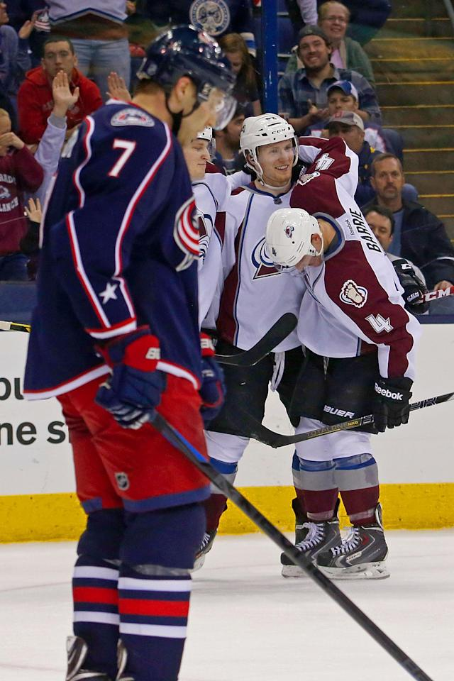 COLUMBUS, OH - APRIL 1: Nathan MacKinnon #29 and Tyson Barrie #4 of the Colorado Avalanche congratulate Gabriel Landeskog #92 on his game-winning goal in the overtime period on April 1, 2014 at Nationwide Arena in Columbus, Ohio. Colorado defeated Columbus 3-2 in overtime. (Photo by Kirk Irwin/Getty Images)