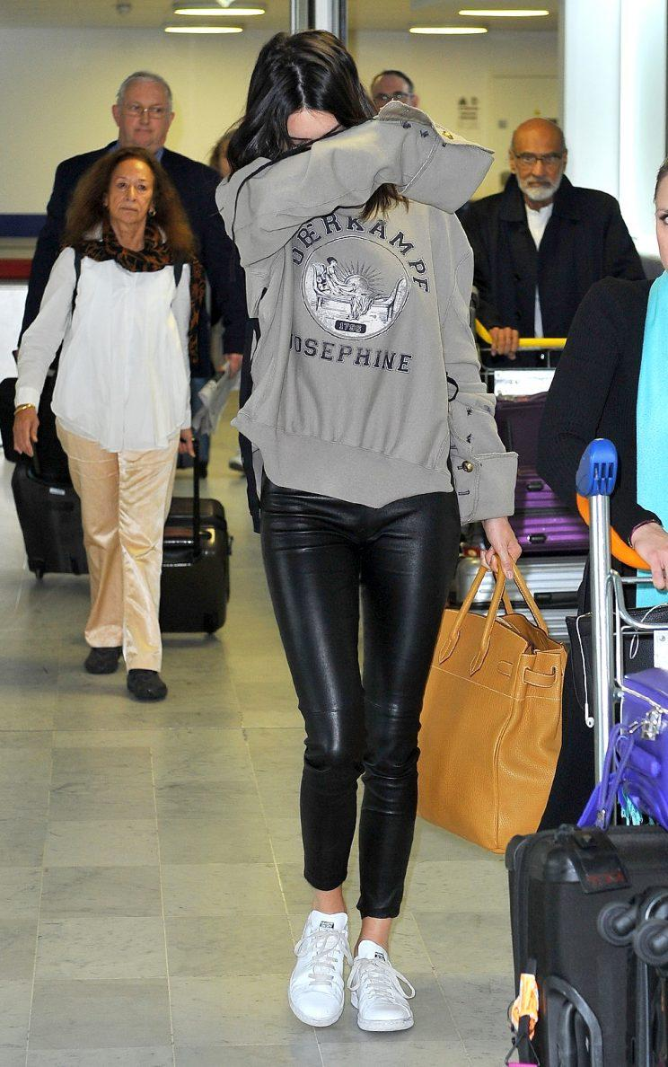Kendall Jenner avoids the cameras as she arrives in Paris, overwhelmed by her recent Pepsi ad scandal.