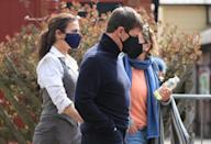 Actor Tom Cruise walks to the set of his latest project, which is filming in the sidings of the railway station in the village of Levisham in the North York Moors