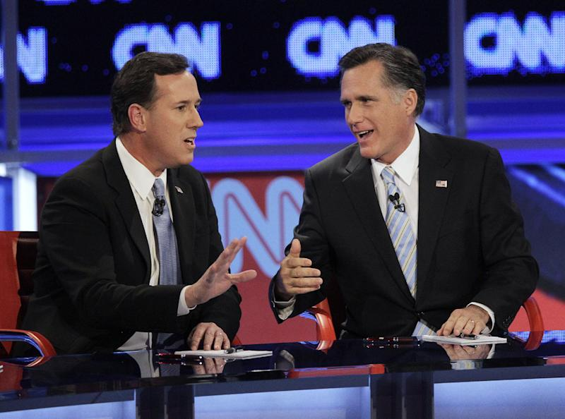 "FILE - In this Feb. 22, 2012, file photo Republican presidential candidates, former Massachusetts Gov. Mitt Romney, right, and former Pennsylvania Sen. Rick Santorum, argue a point during a Republican presidential debate in Mesa, Ariz, during which Santorum confronted Romney about ""Obamacare"". All four GOP candidates now promise to repeal ""Obamacare,"" with Santorum calling it ""the death knell for freedom."" Its model was a Massachusetts law signed by frontrunner Romney, when he was governor. (AP Photo/Jae C. Hong, File)"