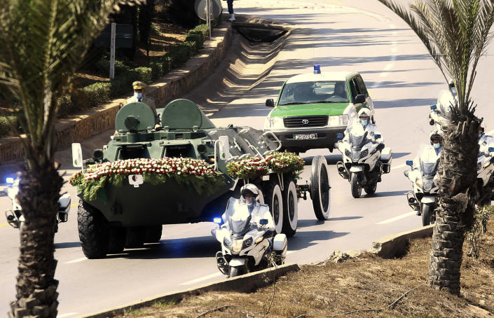 The convoy carrying the coffin of former Algerian President Abdelaziz Bouteflika drives on its way to the El Alia cemetery in Algiers, Sunday, Sept.19, 202. Algeria's leader declared a three-day period of mourning starting Saturday for former President Abdelaziz Bouteflika, whose 20-year-long rule, riddled with corruption, ended in disgrace as he was pushed from power amid huge street protests when he decided to seek a new term. Bouteflika, who had been ailing since a stroke in 2013, died Friday at 84. (AP Photo/Fateh Guidoum)
