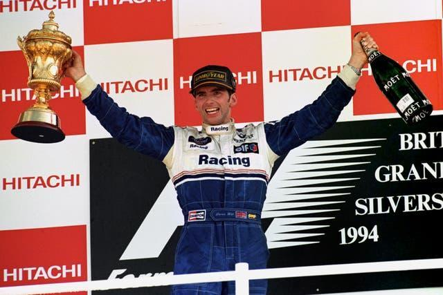 Damon Hill celebrates after winning a controversial British GP