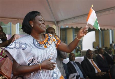 Simone, wife of Ivory Coast's President Laurent Gbagbo, gestures during the opening ceremony of celebrations marking the 50th anniversary of the country's indepedence in Abidjan