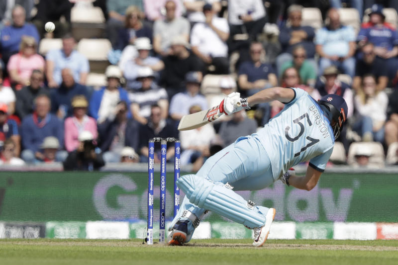 England's Jonny Bairstow ducks a bouncer from West Indies' Andre Russell during the Cricket World Cup match between England and West Indies at the Hampshire Bowl in Southampton, England, Friday, June 14, 2019. (AP Photo/Matt Dunham)