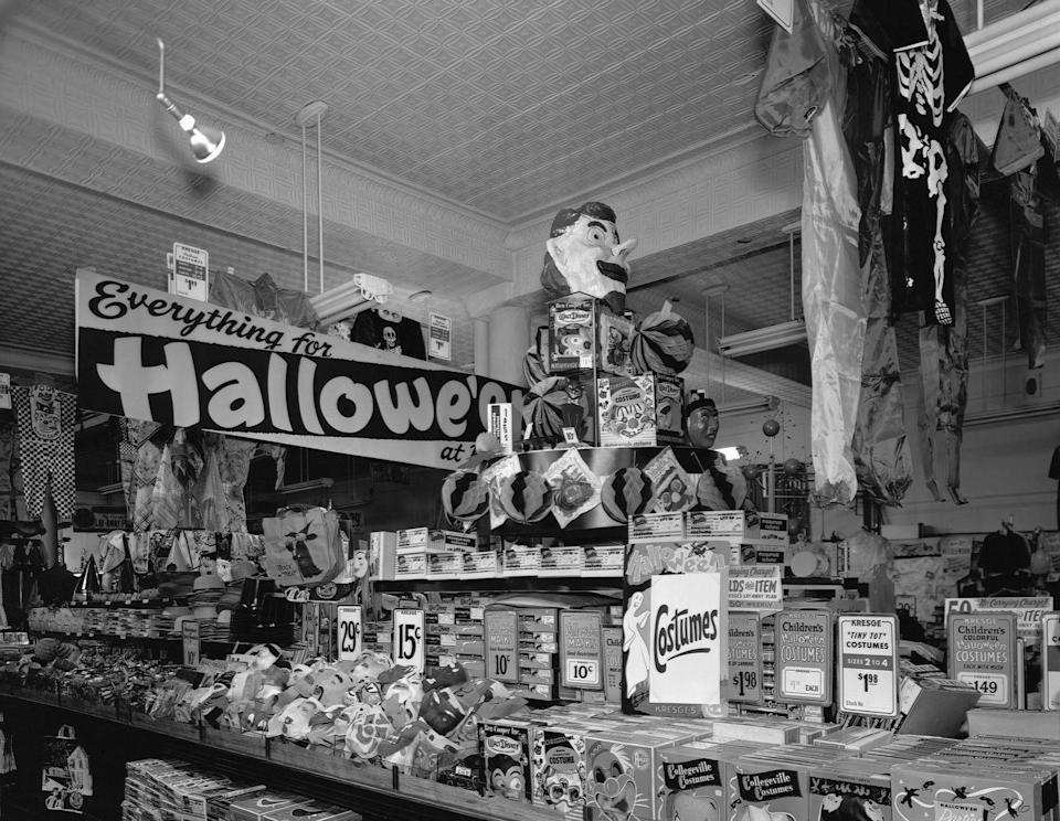 <p>A display table at a store in 1950 Minneapolis called Kredge's housed everything you could want from a Halloween store. </p>