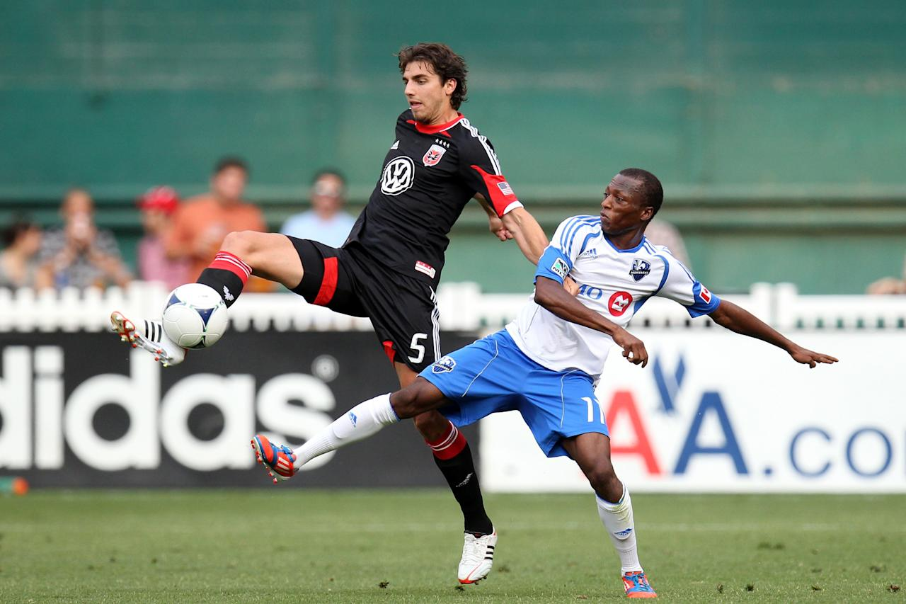 WASHINGTON, DC - JUNE 30: Dejan Jakovic #5 of D.C. United controls the ball against Sanna Nyassi #11 of the Montreal Impact at RFK Stadium on June 30, 2012 in Washington, DC.(Photo by Ned Dishman/Getty Images)