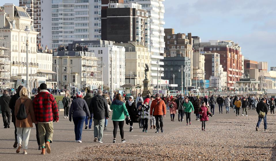 People on the seafront in Brighton during England's third national lockdown.