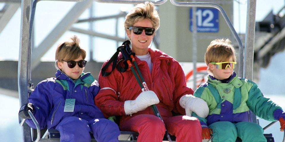<p>During a ski trip in Lech, Austria, Princess Diana rides the lift with both Harry and William. </p>