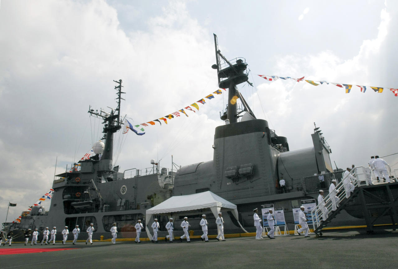 Philippine Navy personnel rush to board the country's newly-acquired Hamilton class warship BRP Gregorio Del Pilar (PF15) during commissioning ceremony Wednesday, Dec. 14, 2011 at the Manila South Harbor in Manila, Philippines. The country's biggest and most modern warship will be deployed to the volatile South China Sea, according to Philippine President Benigno Aquino III. (AP Photo/Bullit Marquez)