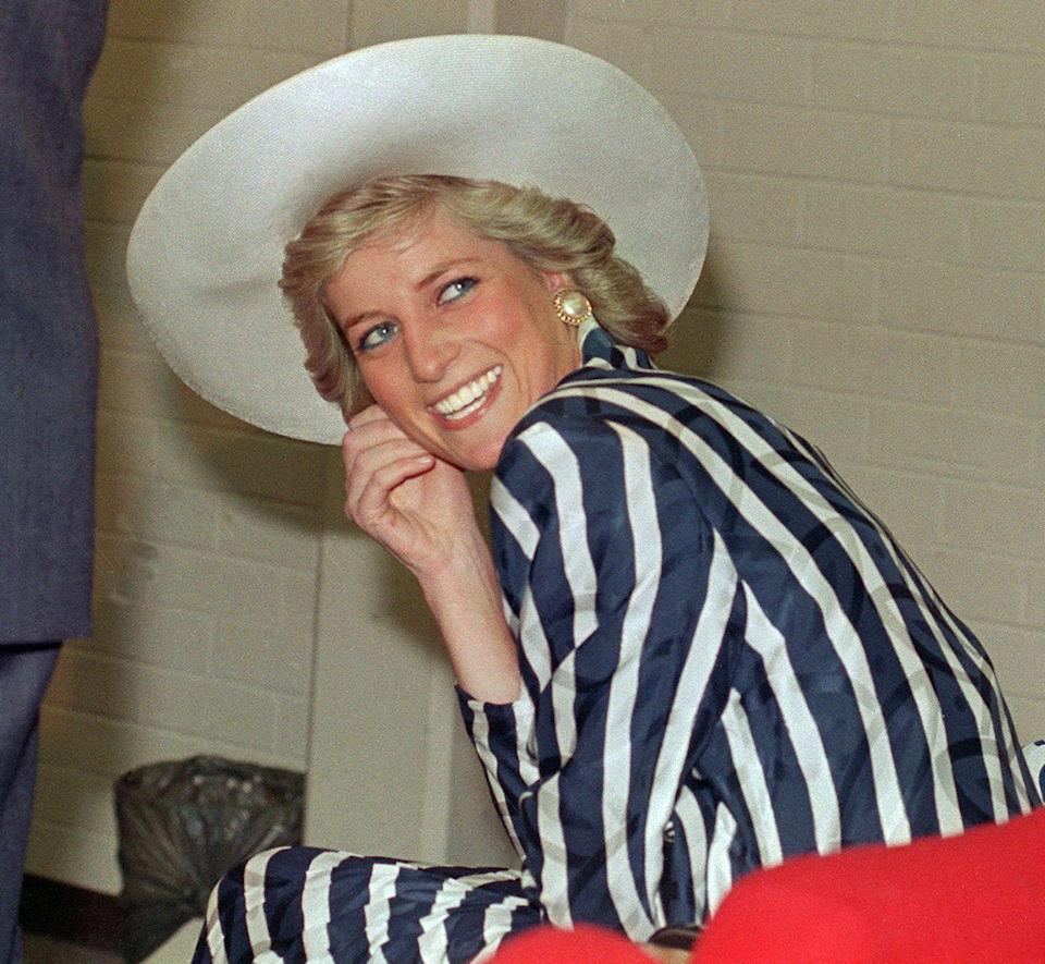 <p>This satin striped look is accessorized perfectly with a wide-brimmed hat and large pearl earrings.</p>