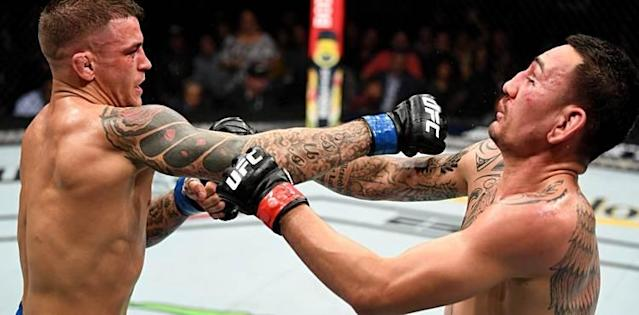 Dustin Poirier straight right punch on Max Holloway at UFC 236