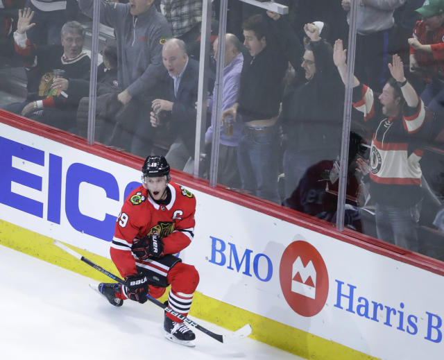 Chicago Blackhawks center Jonathan Toews and fans celebrate his overtime goal against the Colorado Avalanche in an NHL hockey game Tuesday, March 6, 2018, in Chicago. The Blackhawks won 2-1. (AP Photo/Kamil Krzaczynski)
