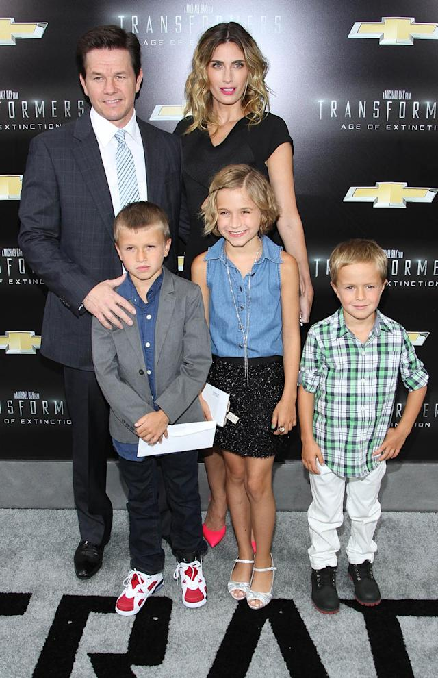 <p>Wahlberg — who replaced LaBeouf as the franchise lead in the fourth installment, <i>Transformers: Age of Extinction</i> — brings wife Rhea Durham and their kids to the New York premiere on June 25, 2014. (Photo: Rob Kim/Getty Images) </p>