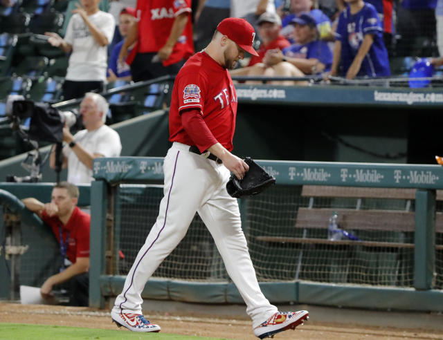 Texas Rangers' Shawn Kelley walks to the dugout after the top of the eighth inning of the team's baseball game against the Minnesota Twins where benches cleared after an exchange between Kelley and Twins' Marwin Gonzalez in Arlington, Texas, Saturday, Aug. 17, 2019. (AP Photo/Tony Gutierrez)