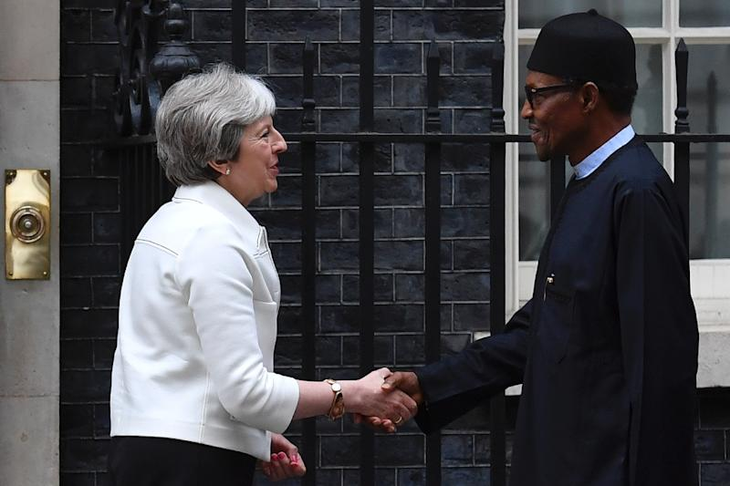 Britain's Prime Minister Theresa May (L) greets Nigeria's President Muhammadu Buhari on the steps of 10 Downing Street in London on April 16, 2018, ahead of a meeting on the sidelines of the Commonwealth Heads of Government Meeting (CHOGM) (AFP Photo/Ben STANSALL)
