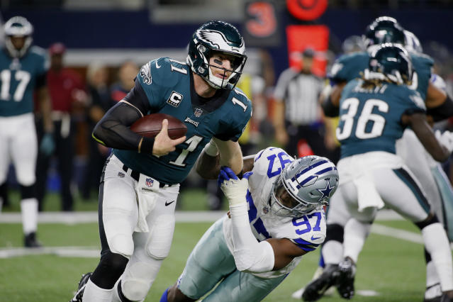 All is right with Carson Wentz and the Eagles. (AP)