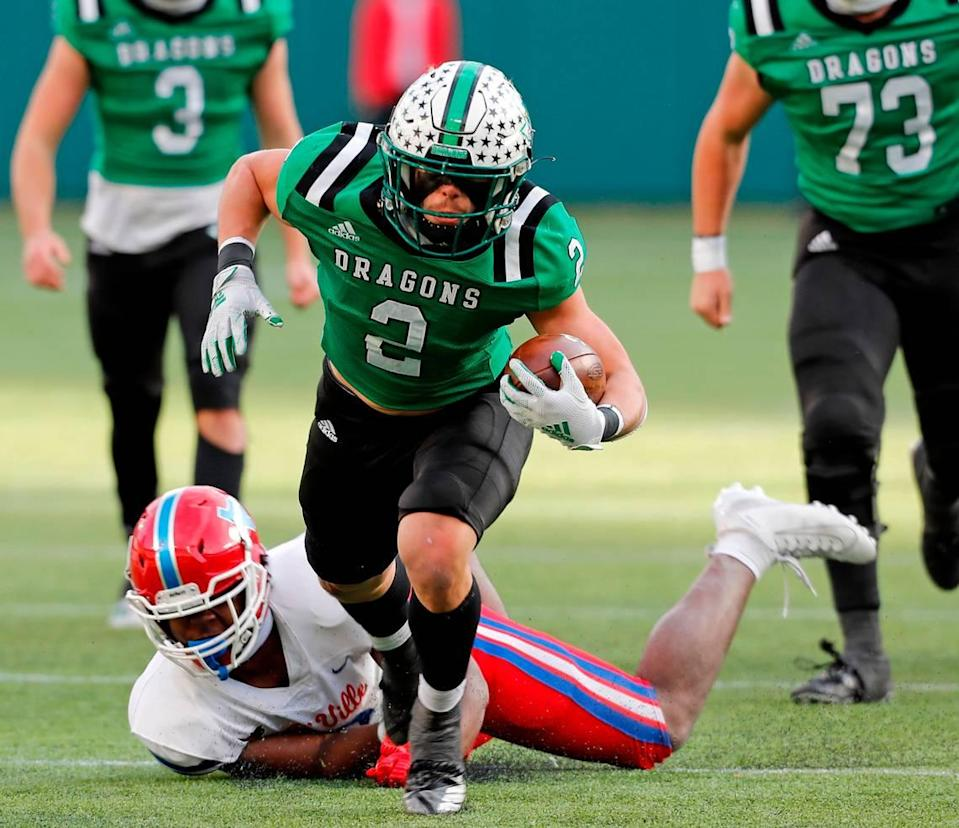 Southlake running back Owen Allen runs the ball upfield during the Conference 6A Division 1 2020 state championship semi-final football game at Globe Life Park in Arlington, Texas, Saturday, Jan. 09, 2021. Duncanville led 27-21 at the half. (Special to the Star-Telegram Bob Booth)