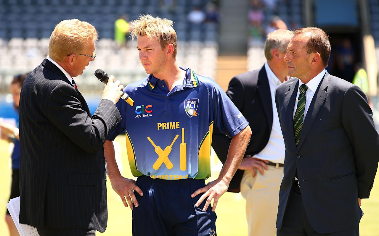 CANBERRA, AUSTRALIA - JANUARY 14:  Brett Lee of the Australian PM's is interviewed with The Australian Prime Minister Tony Abbott after the coin toss before the International tour match between the Prime Minister's XI and England at Manuka Oval on January 14, 2014 in Canberra, Australia.  (Photo by Mark Nolan/Getty Images)