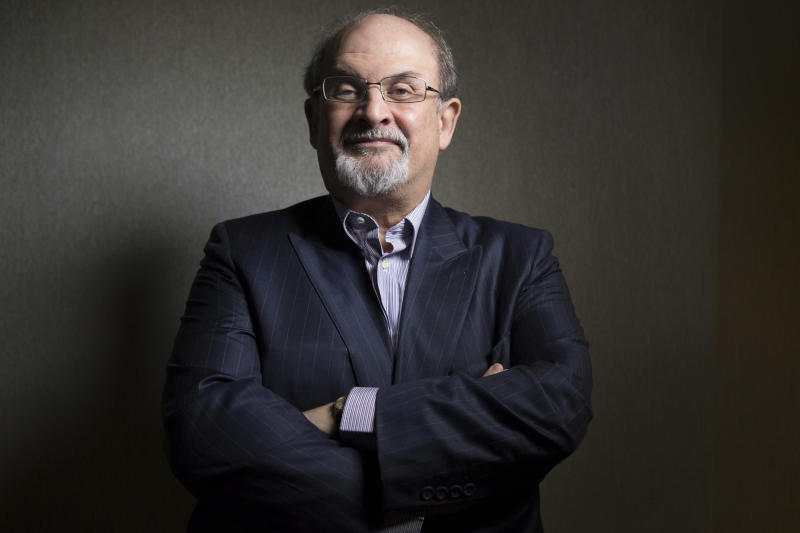 "FILE - This Sept. 8, 2012 file photo shows author Salman Rushdie posing during the 2012 Toronto International Film Festival in Toronto. Rushdie is promoting the film adaptation of his breakthrough novel, ""Midnight's Children,"" winner of the Booker Prize in 1981 and one of the most highly praised works of fiction of its time. (AP Photo/The Canadian Presss, Chris Young, file)"