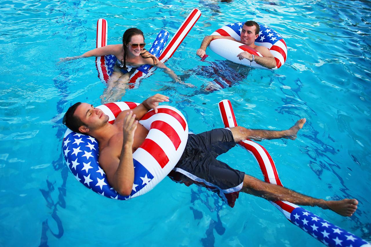 Matt Alleva (front) along with other students play in the campus pool prior to the debate between U.S. President Barack Obama and Republican presidential candidate Mitt Romney at Lynn University on October 22, 2012 in Boca Raton, Florida. The focus for the final presidential debate before Election Day on November 6 is foreign policy.  (Photo by Joe Raedle/Getty Images)