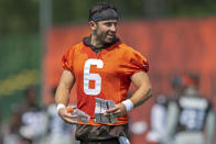 Cleveland Browns quarterback Baker Mayfield (6) smiles while talking during NFL football practice in Berea, Ohio, Wednesday, July 28, 2021. (AP Photo/David Dermer)