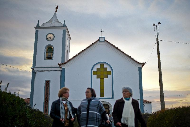 Due to a shortage of catholic priests, laywomen lead Sunday services in churches of rural parishes in some areas of Portugal (AFP Photo/PATRICIA DE MELO MOREIRA)